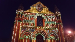 Lights on a cathedral in Poitiers show what the church may have looked before the frescoes on the outside wore off.